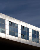 Modern metallic architecture against a blue sky — Stock Photo