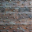 The old wooden surface with metal knobs — Stock Photo