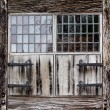 Window shutters of a farmhouse — Stock Photo