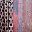 Stock Photo: Old rusty chains on rotor