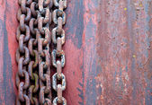 Old rusty chains on rotor — Stock Photo