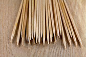 The pile of toothpicks on wooden surface — Stock Photo
