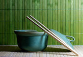 Teapot and chopsticks against straw background — 图库照片