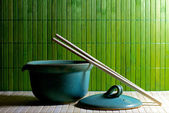 Teapot and chopsticks on straw background — 图库照片