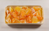 Candied fruits in wooden box — Stock Photo