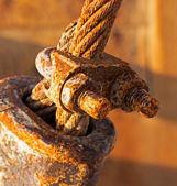 Rusty and a rope in sunlight — Stock Photo