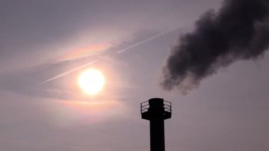 Smokestack against sky and the sun — Stockvideo