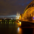 Bridge on River Rhine against Cologne Cathedral at night — Stock Photo #45690973