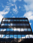 Glass architecture and reflection of the sky und cloud — Stock Photo