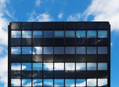 Glass architecture and reflection of sky und cloud — Stock Photo