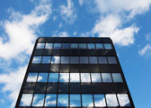 Modern glass architecture and reflection of sky — Stock Photo