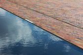 Cobbles and surface water in sunshine — Stock Photo