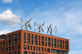 Wind turbines on the roof of a building  — Stock Photo