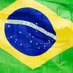 Brazilian flag in wind in the sunlight — Stock Photo #48688739
