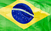 Brazilian flag in wind in the sunlight — Stock Photo