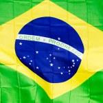 Brazilian flag in the wind in unlight — Stock Photo #48818849