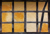 Old adobe wall of half timbered house — Stock Photo
