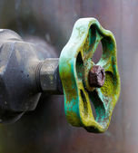 Old valve of a pipeline close up — Stock Photo