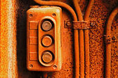 Old electric switch on rusty iron wall — Stock Photo