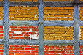 Old adobe and brick wall of half timbered house — Stock Photo