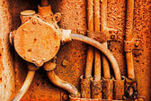 Old electrical cables on the rusty iron wall — Stock Photo
