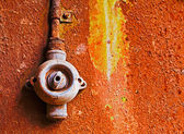 Old switch on rusty iron wall — Stock Photo