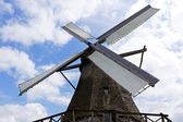 Windmill against a blue sky in sunlight — Stock Photo