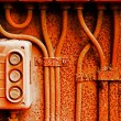 Old electric switch on rusty iron wall — Stock Photo #49924479