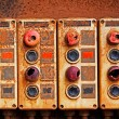 Old electric switches on rusty iron wall — Stock Photo #49924525