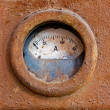 Old meter on rusty iron surface — Stock Photo #49925401