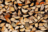 Background of a stack old firewood — Stock Photo