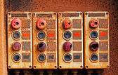 Old electric switches on rusty iron wall — Stock Photo