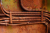Old electrical cables on dirty rusty iron wall — Stock Photo