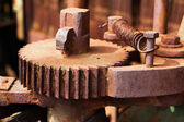 Old and rusty pinion gear of machine in factory — Stock Photo
