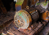 Old electric motor in abandoned factory — Stock Photo