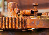 Old and rusty pinion gear of a machine in factory — Stock Photo