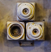 The old ceramic fuses on a wall — Stock Photo