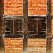 Window with shutters in brick wall of half timbered house — Stock Photo #51416793