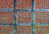 Brick wall of half timbered house — Stock Photo