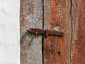 iron latch on a wooden door — Stock Photo