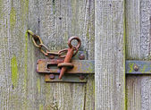 Iron latch on the wooden door — Stock Photo