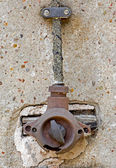 Old electric switch on a concrete wall — 图库照片