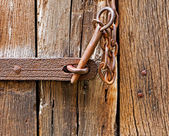 The iron latch on wooden door — Stock Photo