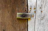 Wooden latch on a wooden door — Stock Photo