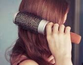 Combing hair — Stock Photo