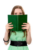 Woman covers her face with a book — Stock Photo