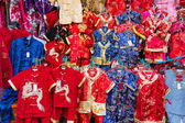 Chinese Red Dress at the Market — Stock Photo
