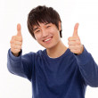 Happy smiling young man show thumb — Stock Photo #14717887