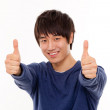 Happy smiling young man show thumb — Stock Photo