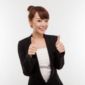 Successful happy Asian businesswoman showing thumb. — Stock Photo